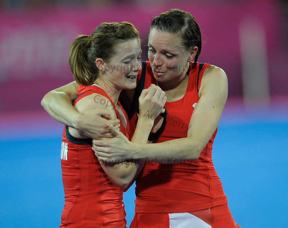 Great Britain's Kate Walsh and Helen Richardson  are tearful after their semi-final at the  London 2012 Olympic hockey tournament, at the Riverbank Arena, Olympic Park, Stratford, East London, 8th August 2012.