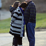 A couple after paying their respects to the shrine created under the school sign in Sandy Hook after yesterday's shootings at Sandy Hook Elementary School, Newtown, Connecticut, USA. 15th December 2012. Photo Tim Clayton