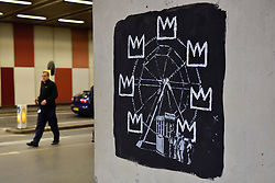 © Licensed to London News Pictures. 18/09/2017. London, UK. Members of the public view one of two new artworks outside the Barbican by street artist Banksy.  The artworks reference the late artist Jean-Michel Basquiat, whose own works will feature in his upcoming first ever UK exhibition at the Barbican Gallery. Photo credit : Stephen Chung/LNP