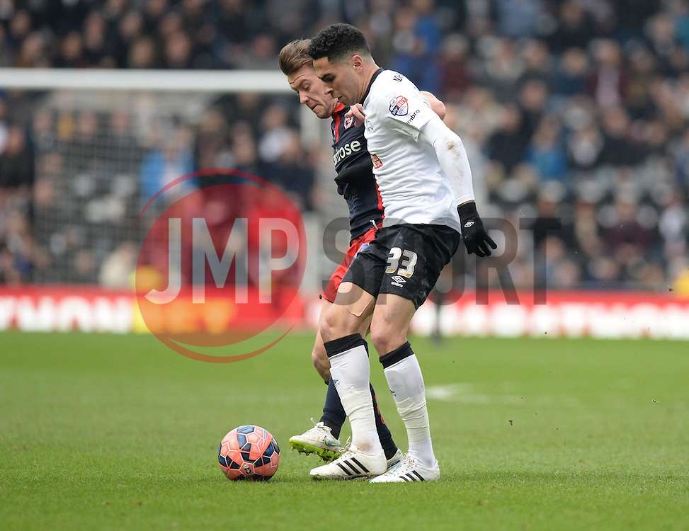 Derby County's Omar Mascarell battles for the ball with Reading's Simon Cox - Photo mandatory by-line: Alex James/JMP - Mobile: 07966 386802 - 14/02/2015 - SPORT - Football - Derby  - ipro stadium - Derby County v Reading - FA Cup - Fifth Round