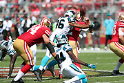 Carolina Panthers defensive end Wes Horton (96) hits San Francisco 49ers quarterback Brian Hoyer (2) and causes a fumble recovered by the Panthers at the Niners 42 yard line during the 2017 NFL week 1 regular season football game against the against the San Francisco 49ers, Sunday, Sept. 10, 2017 in Santa Clara, Calif. The Panthers won the game 23-3. (©Paul Anthony Spinelli)