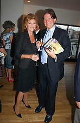 JOHN MADEJSKI and tv presenter CILLA BLACK at a party to celebrate the publication of Glass Houses by Sandra Howard held at Tamesa, Oxo Tower Wharf, Barge House Street, London SE1 on 5th September 2006.<br />