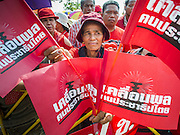 April 6, 2014 - Bangkok, Bangkok, Thailand - <br /> <br /> Red Shirts Rally in Bangkok Suburbs<br /> <br /> A Red Shirt supporter framed by Red Shirt flags at a Red Shirt rally in the Bangkok suburbs Sunday. Red Shirts and supporters of the government of Yingluck Shinawatra, the Prime Minister of Thailand, gathered in a suburb of Bangkok this weekend to show support for the government. The Thai government is dealing with ongoing protests led by anti-government activists. Legal challenges filed by critics of the government could bring the government down as soon as the end of April. The Red Shirt rally this weekend was to show support for the government, which public opinion polls show still has the support of most of the electorate. <br /> ©Exclusivepix