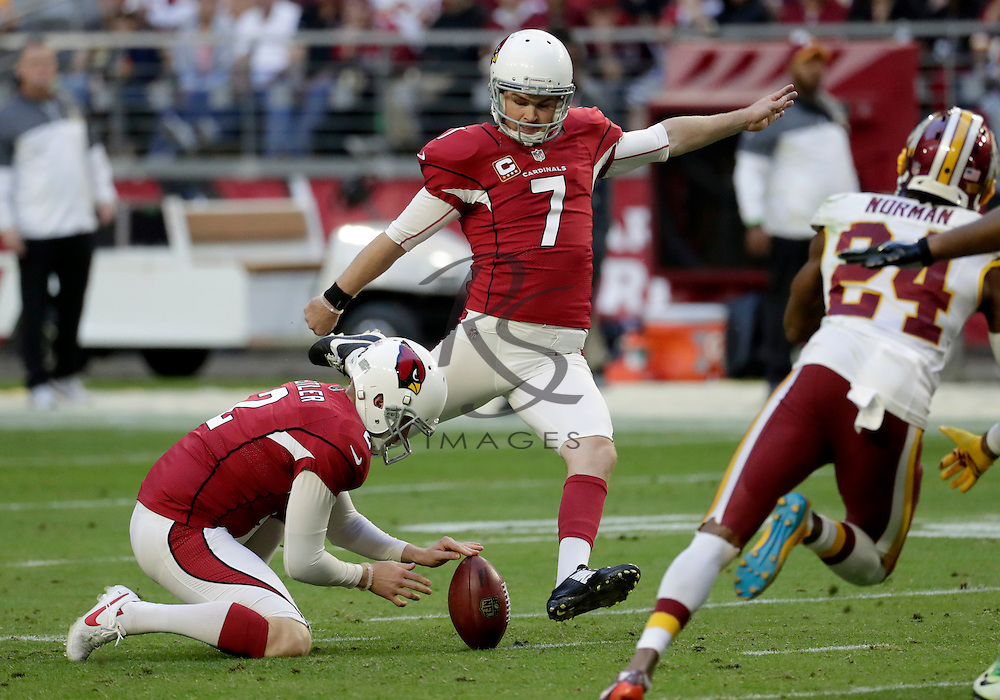 Arizona Cardinals kicker Chandler Catanzaro (7) kicks a missed field goal attempt as punter Drew Butler (2)  holds during the second half of an NFL football game against the Washington Redskins, Sunday, Dec. 4, 2016, in Glendale, Ariz. (AP Photo/Rick Scuteri)
