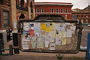 The community message board bears remnants of decades of paper posts in Bisbee, Arizona, USA.