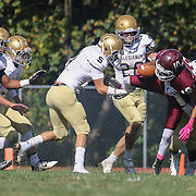 Concord wide receiver Eryk Davis (10) is tackle by Salesianum linebacker Joshua Patrick (8) in the second quarter Saturday, Oct. 17, 2015 at Concord Stadium in Wilmington.