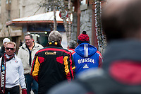 Friends walk Village Stroll wearing Canada and Russia jackets on the day of the hockey tournament between the two nations during the 2010 Olympic Winter Games in Whistler, BC Canada.