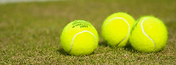 LONDON, ENGLAND - Saturday, June 27, 2009: Three tennis balls during the Boys' Singles 1st Round match on day six of the Wimbledon Lawn Tennis Championships at the All England Lawn Tennis and Croquet Club. (Pic by David Rawcliffe/Propaganda)