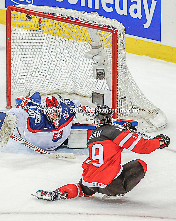 Team Canada player, Nick Petan (19), scores top shelf goal during the 2015 IIHF Junior World Championships.