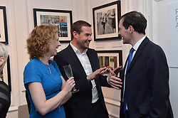 The Chancellor George Osborne with Photographer Andrew Parsons and his wife Karen as he attends the opening of the Royalty, Politics and War: the art of the photojournalist Andrew Parsons Opening Night exhibition at the Ellwood Artfield Gallery, Westminster London, The images will be sold to raise money for Great Ormond Street Hospital after Andrew's daughter was diagnosed with leukaemia in August 2012, Tuesday, 13th May 2014. Picture by Ben Stevens / i-Images
