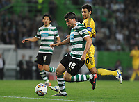 20120329: LISBON, PORTUGAL - Football - UEFA Europe League 2011/2012 - Quarter-finals, First leg: Sporting CP vs Metalist<br /> In picture: Sporting's Emiliano Insua, from Argentine, controls the ball.<br /> PHOTO: Alvaro Isidoro/CITYFILES