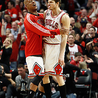16 April 2011: Chicago Bulls shooting guard Keith Bogans (6) celebrates with Chicago Bulls shooting guard Kyle Korver (26) during the Chicago Bulls 104-99 victory over the Indiana Pacers, during the game 1 of the Eastern Conference first round at the United Center, Chicago, Illinois, USA.