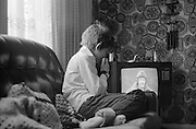 Neville on Couch Watching Swap Shop in front Room, High Wycombe, UK, 1980s.