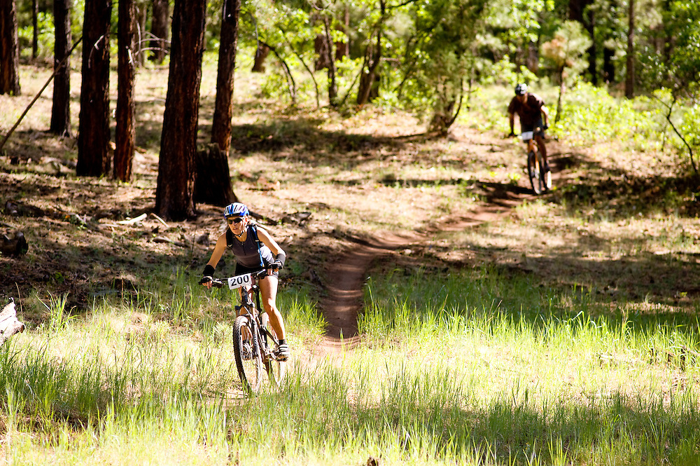 Racers descend a drainage on the Smokin Handlebar Trail.