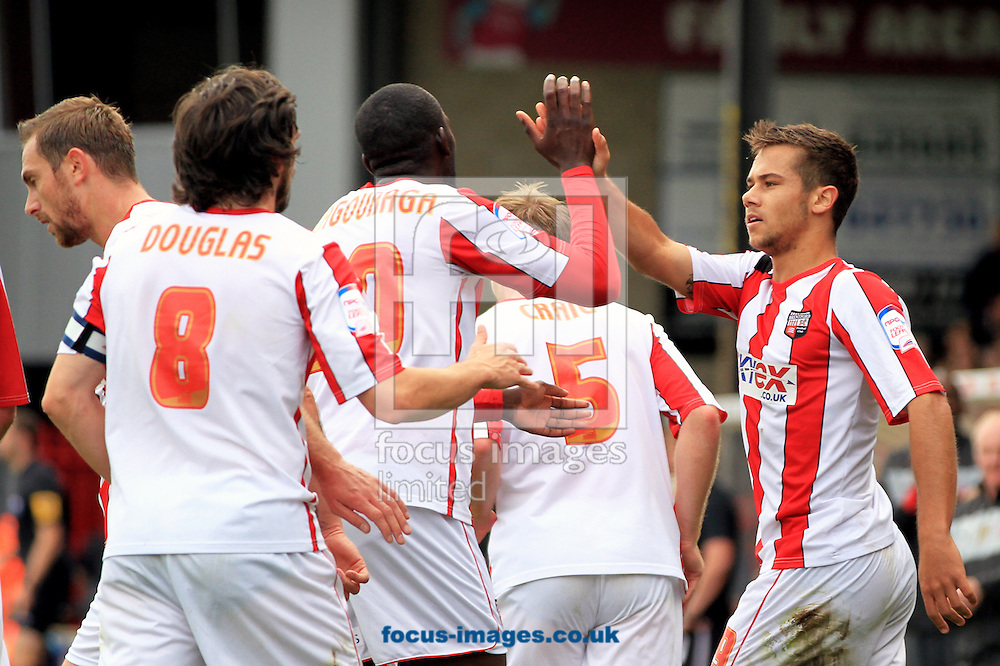 Picture by Richard Gould/Focus Images Ltd +447814 482222.13/10/2012.Harry Forrester ( R ) of Brentford celebrates his goal and high fives with Toumani Diagouraga during the npower League 1 match at Glanford Park, Scunthorpe.