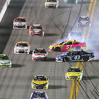 NASCAR Sprint Cup drivers AJ Allmendiner (51) and Aric Almirola (43)  wreck during the NASCAR Coke Zero 400 Sprint series auto race at the Daytona International Speedway on Saturday, July 6, 2013 in Daytona Beach, Florida.  (AP Photo/Alex Menendez)
