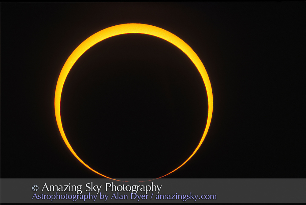 May 10, 1994 Annular Eclipse<br /> taken from a site east of Douglas Arizona<br /> Showing &quot;reverse&quot; Bailey's Beads -- lunar mountains just touching Sun's limb<br /> 4-inch f/6 apo refractor at f/15 with Barlow lens<br /> Ektachrome 100 slide film.