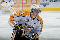 KELOWNA, CANADA - OCTOBER 25: Tyler Coulter #21 of Brandon Wheat Kings skates against the Kelowna Rockets on October 25, 2014 at Prospera Place in Kelowna, British Columbia, Canada.  (Photo by Marissa Baecker/Getty Images)  *** Local Caption *** Tyler Coulter;