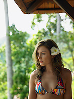 Young Woman in Bikini with Flower in Hair