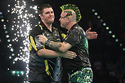 Peter Wright congratulates Daryl Gurney on his victory during the PDC Premier League Darts at Arena Birmingham, Birmingham, United Kingdom on 25 April 2019.