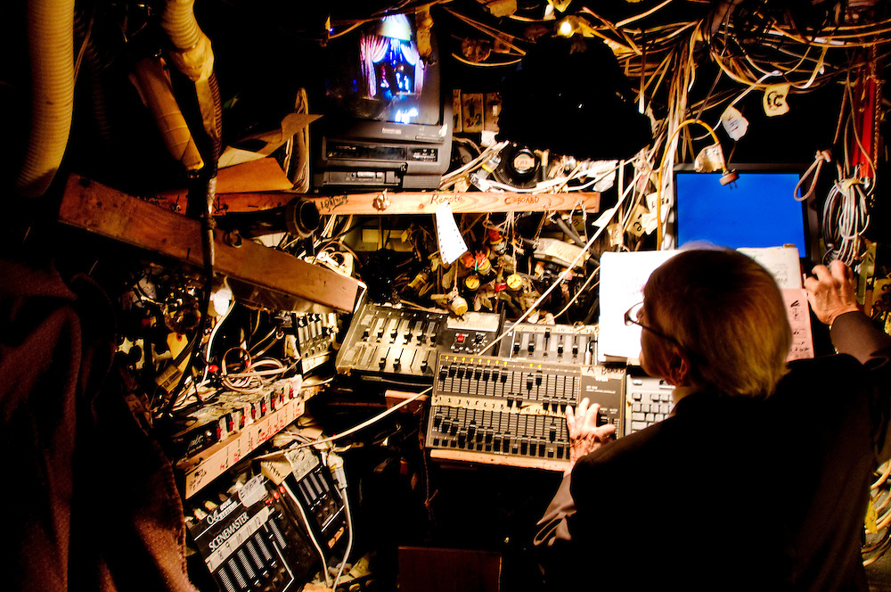 Amato Opera <br /> <br /> Tony Amato at the light and sound control board under the stage during a performance.<br /> <br /> The Amato Opera company was founded by husband and wife Tony and Sally Amato in 1948. <br /> <br /> The opera house is located on The Bowery, in New York's East Village,  next door to where the legendary punk rock club CBGB used to be.<br /> <br /> While Tony acted as artistic director, selecting the productions, auditioning and casting, rehearsing and training the cast and conducting most of the performances, his wife Sally functioned as seamstress, light board operator, cook, box office manager, publicist, business manager, and, as Serafina Bellantoni, singer for the company until her death in 2000.<br /> <br /> Today Tony at the age of 88 is still running the company like he promised his wife he would, and the Amato Opera maintains its goals of providing opera at a reasonable price and giving promising singers stage experience in full-lenght productions.<br /> <br /> Photographer: Chris Maluszynski /MOMENT