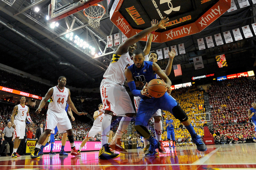16 February 2013:   Duke Blue Devils forward Josh Hairston (15)  in action against Maryland Terrapins forward Charles Mitchell (0) and guard Seth Allen (4) at the Comcast Center in College Park, MD. where the Maryland Terrapins upset the second ranked Duke Blue Devils, 83-81.