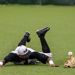 Alabama State outfielder Joseph Estrada (8) loses his glove after diving for a shallow pop fly against the Texas Southern during the top of the thirteenth inning of the SWAC baseball championship final in New Orleans, La. Sunday, May 21, 2017.