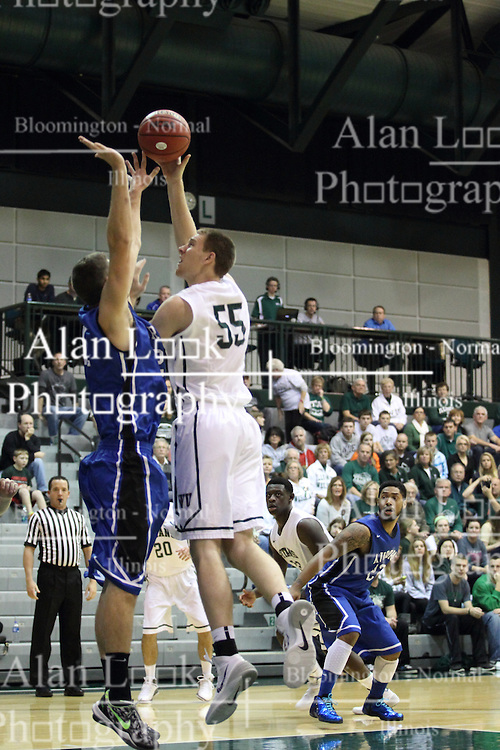 16 November 2013:  Nick Anderson gets an up and over during an NCAA mens division 3 basketball game between the Aurora University Spartans  and the Illinois Wesleyan Titans in Shirk Center, Bloomington IL