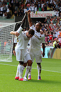 Swansea city's Wayne Routledge ® celebrates with teammates Danny Graham © and Nathan Dyer (l) after he scores his sides 1st goal.  Barclays Premier league, Swansea city v Sunderland at the Liberty Stadium in Swansea, South Wales on Saturday 1st Sept 2012. pic by Andrew Orchard, Andrew Orchard sports photography,