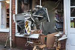 © Licensed to London News Pictures. 04/01/2016. Long Ashton, North Somerset, UK. Extensive damage to a cashpoint and the front of the Post Office in Long Ashton near Bristol which has been destroyed in what is thought to have been a robbery using gas to blow up the cashpoint which happened about 3.30am today. Cash has been taken and three people have been arrested and are being held on suspicion of causing an explosion with intent to endanger life. There have been up to a dozen other similar attacks on cashpoints in the Bristol area in the last year or two. Photo credit : Simon Chapman/LNP