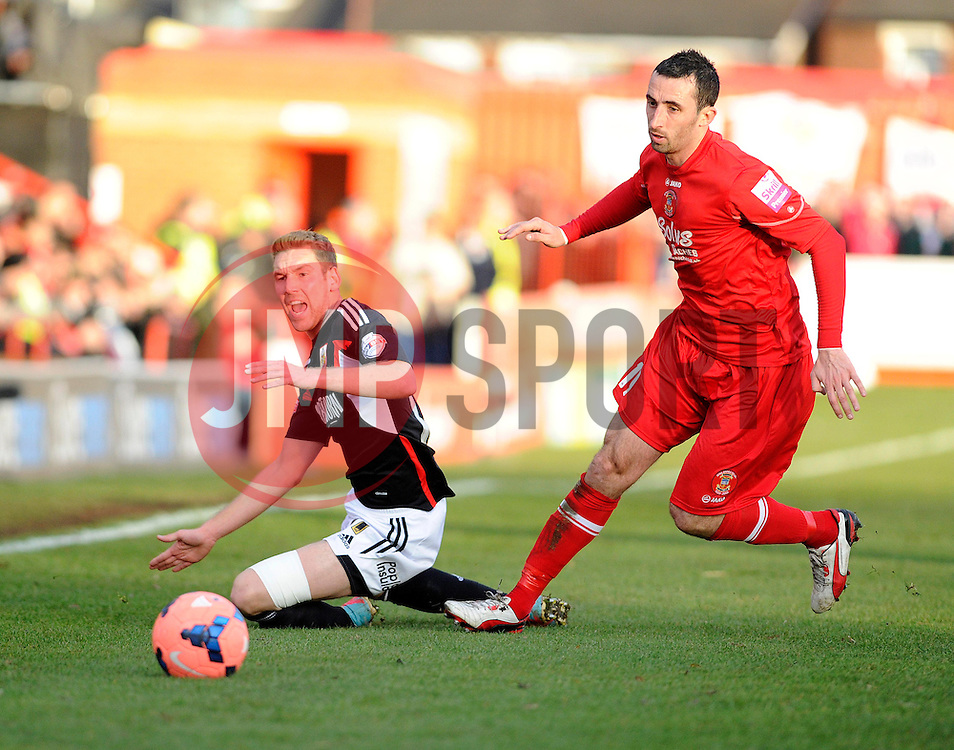 Bristol City's Scott Wagstaff falls under a challenge from Tamworth's Tony Capaldi - Photo mandatory by-line: Dougie Allward/JMP - Tel: Mobile: 07966 386802 08/12/2013 - SPORT - Football - Tamworth - The Lamb Ground - Tamworth v Bristol City - FA Cup - Second Round