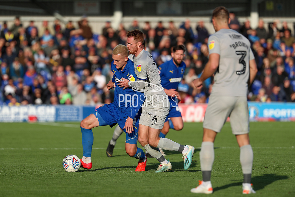 AFC Wimbledon striker Joe Pigott (39) battles for possession with Portsmouth midfielder Tom Naylor (4) during the EFL Sky Bet League 1 match between AFC Wimbledon and Portsmouth at the Cherry Red Records Stadium, Kingston, England on 19 October 2019.