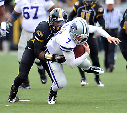 Nov 13, 2010; Columbia, MO, USA; Kansas State Wildcats quarterback Collin Klein (7) is tackled by Missouri Tigers safety Jasper Simmons (9) in the first half at Memorial Stadium. Missouri won 38-28.  Mandatory Credit: Denny Medley-US PRESSWIRE