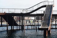 A composition photograph of a bridge in the harbour waters of Bølgen, Copenhagen.