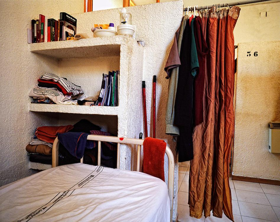 Barcelona,Spain.<br /> Reading in the prison.<br /> A cell in the geriatric of the Modelo prison.&copy;Carmen Secanella