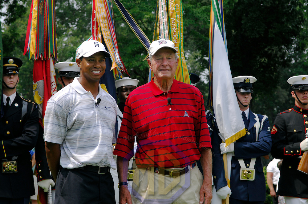 04 July 2007:  Former President George H. W. Bush (R) stands with Tiger Woods (L) after Bush teed off to start the inaugural AT&T National PGA event at Congressional Country Club in Bethesda, Md. The proceeds of the golf tournament will benefit the Tiger Woods Foundation and local Washington, DC, based charities.   ****For Editorial Use Only