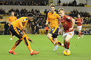 Nottingham Forest midfielder Ben Osborn takes on Wolverhampton Wanderers defender Dominic Iorfa during the Sky Bet Championship match between Wolverhampton Wanderers and Nottingham Forest at Molineux, Wolverhampton, England on 11 December 2015. Photo by Alan Franklin.