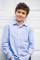 Smiling mixed race boy with hands in pockets
