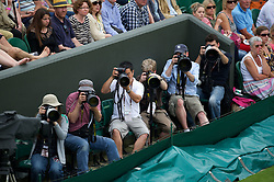 26.06.2012, Wimbledon, London, GBR, WTA, The Championships Wimbledon, im Bild Press photographers during day two of the WTA Tour Wimbledon Lawn Tennis Championships at the All England Lawn Tennis and Croquet Club, London, Great Britain on 2012/06/26. EXPA Pictures © 2012, PhotoCredit: EXPA/ Propagandaphoto/ David Rawcliff..***** ATTENTION - OUT OF ENG, GBR, UK *****
