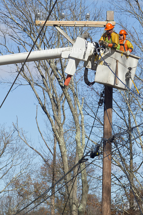 Goshen, New York - Utility crews repair electric lines on Knoell Road damaged by high winds during Hurricane Sandy on Nov. 4, 2012. The road was closed earlier in the week because of fallen trees.