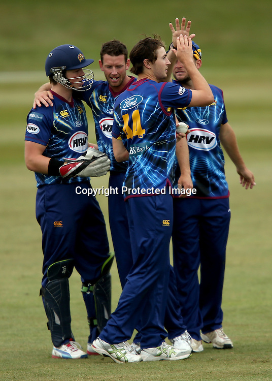 Otago team mates celebrate during the HRV Cup Twenty20 Cricket match between Canterbury Wizards and Otago Volts at Aorangi Oval, Timaru on Thursday 27 December 2012. Photo: Martin Hunter/Photosport.co.nz