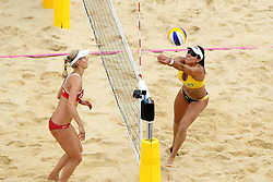 Sara Goller of Germany and Maria Antonelli of Brazil during the Women's Beach Volleyball Preliminary Phase Pool E match between Brazil and Germany held at the Horse Guards Parade stadium in London as part of the London 2012 Olympics on the 31st July 2012.Photo by Ron Gaunt/SPORTZPICS