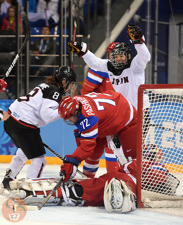 Feb 16, 2014; Sochi, RUSSIA; Japan forward Rui Ukita (15) celebrates after scoring a goal past Russia goalkeeper Anna Prugova (1) in a women's ice hockey classifications round game during the Sochi 2014 Olympic Winter Games at Shayba Arena.