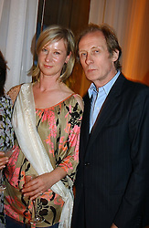 JOANNA JOHNSTON and BILL NIGHY at a party at The Sanderson Hotel, Bernnnnners Street, London in aid of Sargent Cancer Care for Children on 7th July 2004.
