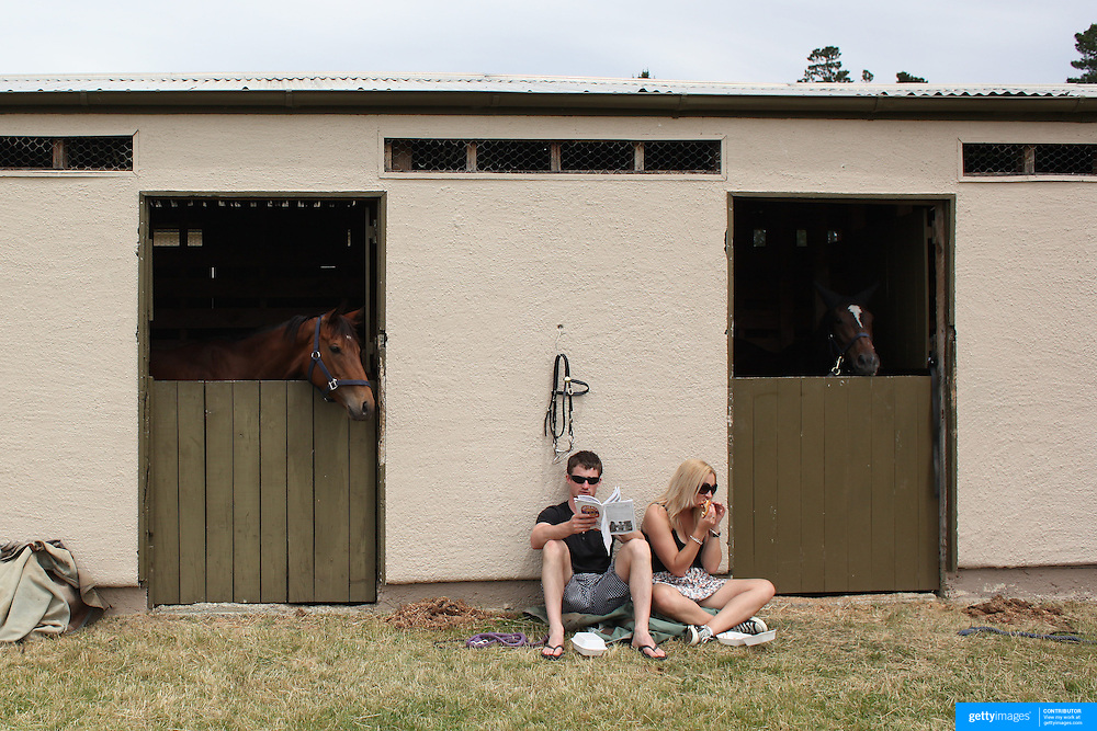 Horse handlers relax at the horse stables during a day at the Races at the Cromwell Race meeting, Cromwell, Central Otago, New Zealand. 27th November 2011. Photo Tim Clayton