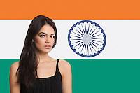Portrait of young woman against Indian flag