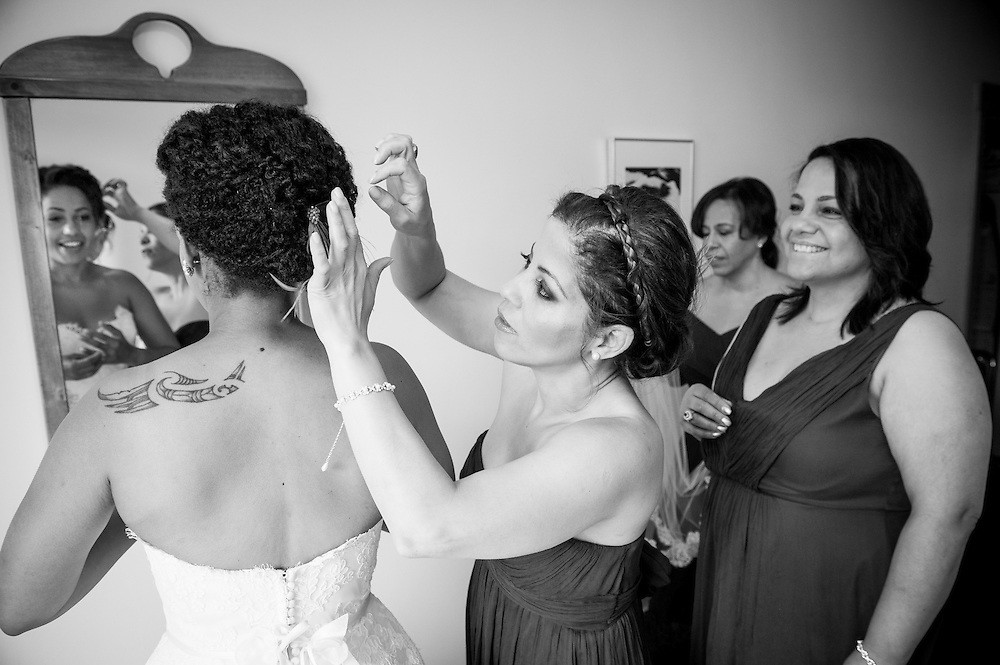 A bride's sister does some final touches with her hair in Brattleboro, VT.