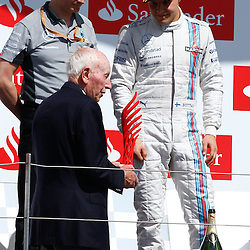 FORMULA 1 SANTANDER BRITISH GRAND PRIX ...Valtteri Bottas being presented with his trophy by Sir John Surtees...(c) STEPHEN LAWSON | SportPix.org.uk