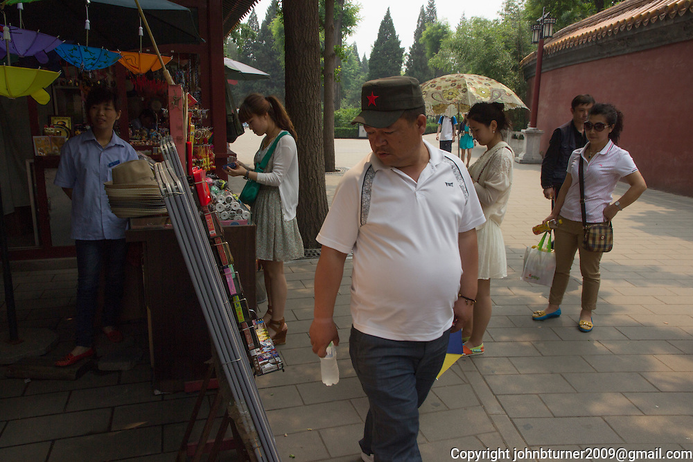 "Just north of the Forbidden City, Jingshan (translated as ""Prospect Hill""), is a handmade hill built specifically to provide panoramic views of Beijing, according to the principles of Feng Shui. Previously called Coal Hill, the 45-metre site is popularly known as Feng Shui Hill, and was built in the era of the third Ming emperor during the 15th century. Jingshan has five individual peaks, each with a pavilion once used by officials for gatherings and leisure. The views are magnificent, especially on a smog-clear day, and with the exponential spread of digital cameras, it has never been easier for friends and family to memorialise their visit with this huge ancient city as backdrop. Known as the 'Rice Dumplings' festival in the north of China, this June holiday is called the 'Dragon Boat' festival in south China."