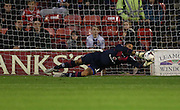 Walsall goalkeeper, Neil Etheridge makes a sprightly save during the Capital One Cup match between Walsall and Brighton and Hove Albion at the Banks's Stadium, Walsall, England on 25 August 2015.